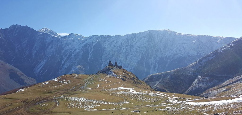 Gergeti Trinity Church From Afar Kazbegi Georgia Caucasus • Travel Georgia